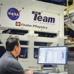 Man controlling vibration test system being used on NASA's James Webb Space Telescope.